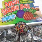 "2.5"" Multi Color Squeeze Black Mesh Balls 12 per display bx .56 each"