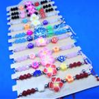 Cord Beaded Fashion Bracelet w/ Fimo Flowers  12 per card .54 ea
