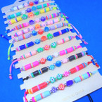 Cord Beaded Bracelet w/ Fimo Flowers  12 per cd .54 each