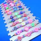 Beaded Cord  Bracelets w/ Triple Fimo Flower 12 per card .54 each