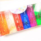 "2"" X 6"" Jumbo Glitter Slime Tubes w/ Dinosaur 6 per display $ 1.10 ea"