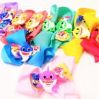 "5"" Gator Clip Bows w/ Cute Shark Theme Print  Asst Light Colors  .54 each"