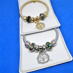 Gold & Silver Spring Style Bracelet w/ Cry. Tree of Life Charms  .54 ea