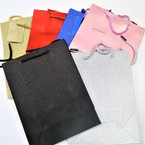 "7"" X 9.5"" Metallic Finish Gift Bags w/ Tag Asst Color .50 each"