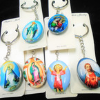 DBL Sided Glass Keychains Oval w/ Saint Theme Pictures   .54 each