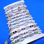 Crystal Beaded Cord  Bracelets w/ Cowrie Shells    12 per card .56 ea