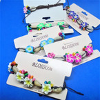 Wood Bead,Fimo Flowers & Cowrie Shells Macrame Bracelets .58 each