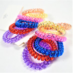 Trendy 6 Pack Phone Coil Ponytailers/Bracelets Transparent Color  .56 per set
