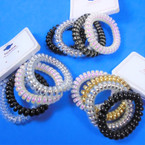 Trendy 4Pack Phone Coil Ponytailers/Bracelets Blk/White/Clear .56 per set