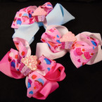 "Multi Layer 5"" Gator Clip Bow  w/ Sparkle Cup Cake  12 per pk  .54 each"