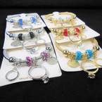 Gold & Silver Spring Style Bracelet w/ Ring Charms & Cry. Stone Bead   .56 ea