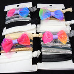 7 Pack Elastic Ponytailers w/ Sparkle Bow .56 per set