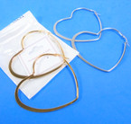 "2.5"" Silver Stainless Steel Heart Shaped Hoop Earrings  $ 1.00 per pair"