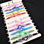 Popular Fimo Hawaiian Flower Bead Cord Bracelets 12 per card .54 each