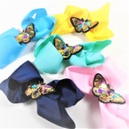 "5.5"" Gator Clip Bows w/  Sequin Butterfly Center  .54 each"