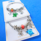 Gold & Silver Spring Style Bracelet w/ Color Bead & Turtle Charms (2999)    .58 each