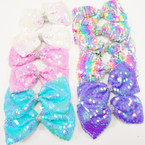 "5.5"" Sequin Gator Clip Bows w/ Cry. Stone Center - Lite Colors   .54 each"