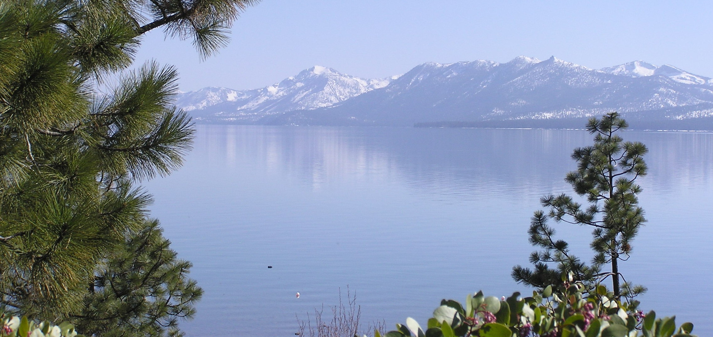 Stunning Lake Tahoe with its snow-covered Sierra Mountains reflecting in the lake.