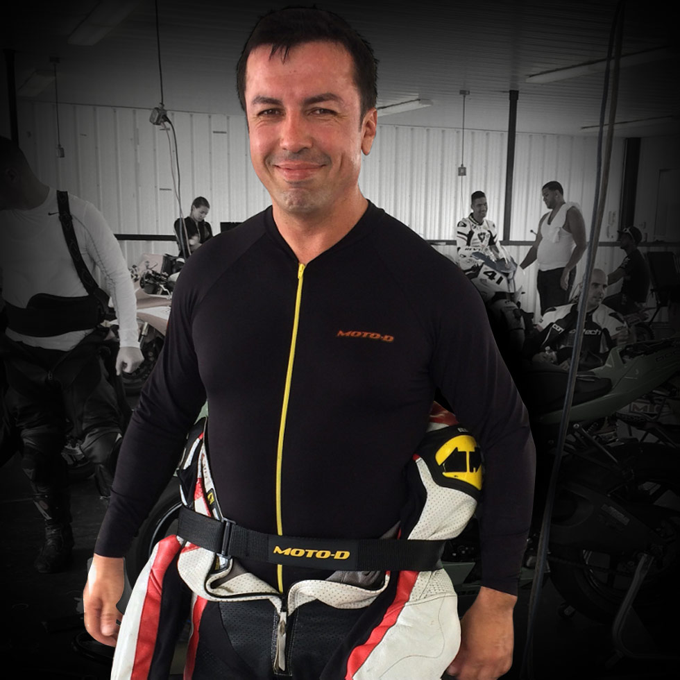track strap keeps motorcycle leathers up