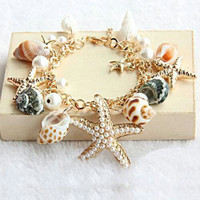 Natural Gold Tone Sea Shell Charm Bracelet