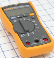 Fluke 117 Electrician's True RMS Multimeter is used to measure electrical quantities.