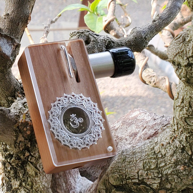 CONNECTED LAUNCH BOX featuring the Crown Chakra symbol etched on acrylic lid over Cherry hardwood