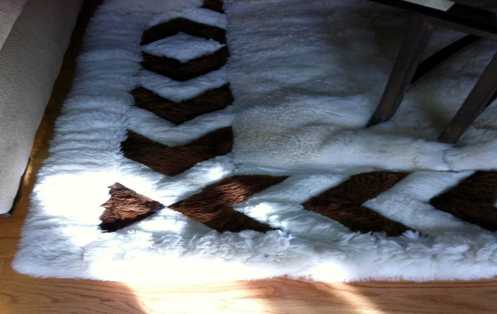 Worn Alpaca fur rug with chevron border