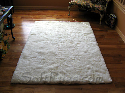 White Sheet Alpaca Fur Rug on Wood Floor