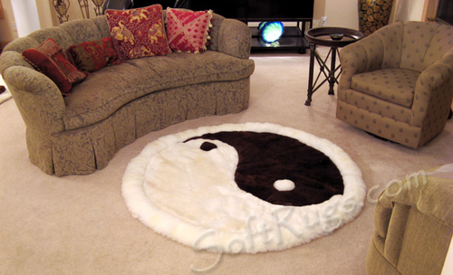 Round Alpaca Rug with Yin-yang pattern. This fur rug features a white border.