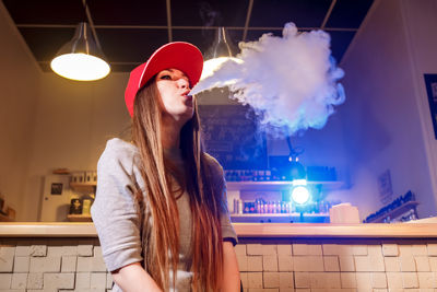 Lady Blowing  Clouds of E Cigarette Vapour