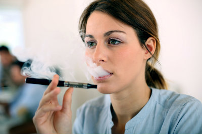 Woman Testing Electronic Cigarette