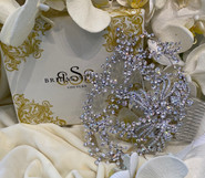 """Elegant custom designed comb.  Encrusted with genuine  CRYSTALS. 5""""wide x 6""""long"""