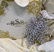 """Classic comb encrusted with genuine Swarovski Crystals. 6.5""""long x 3.5""""wide"""
