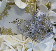 """Dramatic large soft wire comb, encrusted with genuine Swarovski Crystals.  6""""x 6"""""""