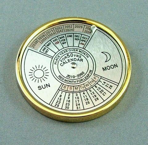 50 year gold bezel/ silver dial calendar