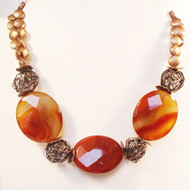Faceted Red Agate with Copper