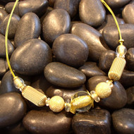 Petite Corrugated Brass Ovals with Gold Foil Glass Beads.