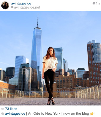 women in black high-waisted jeans with world trade center