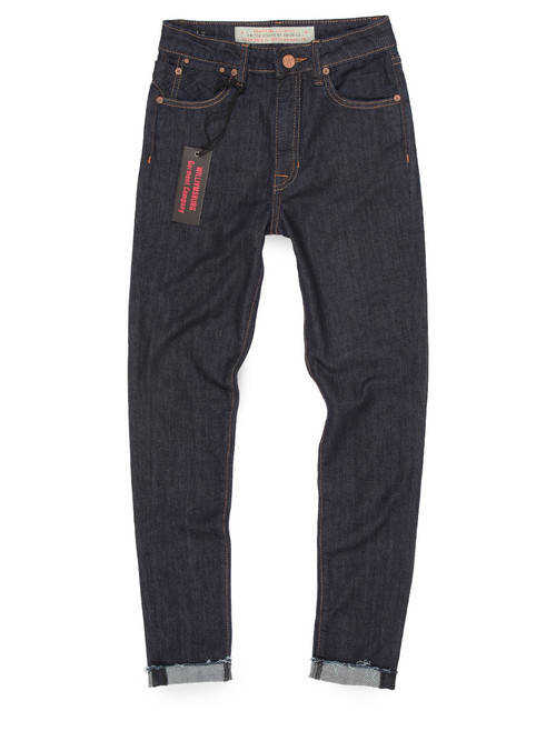 High waisted jeans with frayed hem in dark washed blue denim.