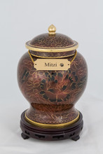 Beautiful classic brown and gold inlaid cloisonne urn. Can be personalized with an urn necklace. Personal engraving included. This urn is estimated to hold the remains of a pet up to 100 lbs. This product is personalized with an urn necklace, allowing you to personalize this urn with your pet's name.