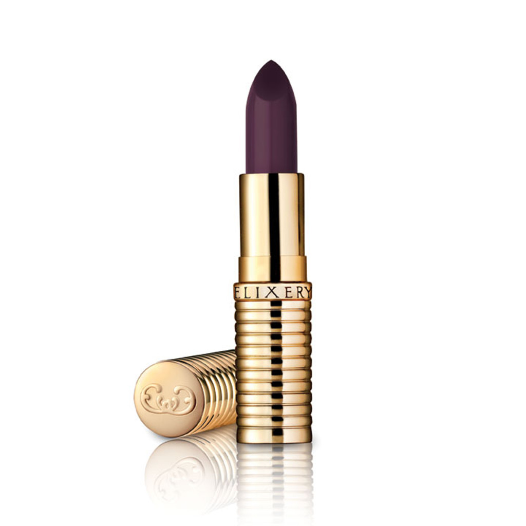 Dark purple lipstick, almost black, in gold container.