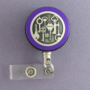 Purple Key Design Badge Reel