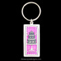 Fancy cake key chain in silver with hot pink.