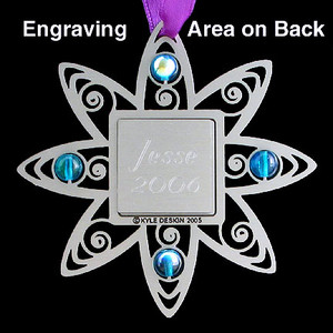 Iris themed metal ornaments may be engraved on back