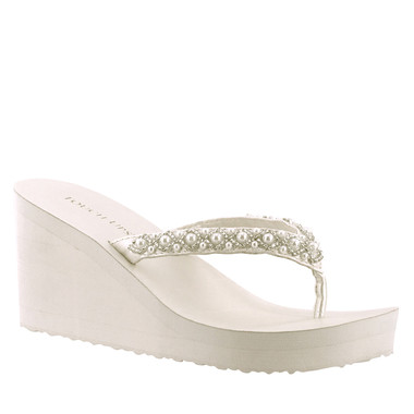 "The Shelly is a fun, new flip flop featuring a 2 1/2"" wedge and pearl accents."