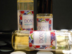 """Doni - An Irresistible Fragrance Blend - Perfume Oil - Roll On Perfume - 10 ml  Doni is a multi-dimensional sensual fragrance and works with you bodyƒ??s chemistry to make you smell even better than ƒ??GRAPEƒ??! Be warned that this fragrance is totally addicting and you won't be able to tear yourself away from it. I love smelling it on myself. The best way to describe this fabulous fragrance is that it is a sensual, sweet and femine. I could drown in Doni and be happy. And this fragrance continues to develop while wearing it due to the reaction with your chemistry. Unbelievable! You'll want all your body products with this fragrance only like me. I'm in love with Doni - Thank you Doni :)  **As Seen on Martha Stewart**  Below is how Doni has been described by some of my GRAPE customers.  """"Love :D :D I wasn't a fan when I smelled it in the bottle. The scent is sweet at first, but not cloyingly so. There is a spiciness(I'm not sure if that's the right word) to the scent that makes it unique and very grown up. """"Incredible scent! It really does change with your chemistry and just gets better.""""  """"I am glad I bought the big version of Doni! I am seriously addicted! Will have to buy another one soon :)""""  """"This fragrance is so unique! You're right, it blends with your own chemistry and I'm sure smells different on everyone... absolutely yummoooo!""""  """"Oh man, I don't even know where to start lol. I ordered so much stuff and was happy with my entire order but I'm gonna comment on my favorites. I LOVE I mean absolutely LOVE the Doni and Jelly Doughnut perfume rollers! Doni actually smells like a high end fragrance that you would find at Macy's. It has a sexiness to it that I can't even describe. It smells so good on my skin. Jelly Doughnut is just what it sounds like :) Delicious! My coworkers kept joking that I was making them hungry and I kept sniffing myself throughout the day. Yep the smell actually lasts all day. .I got compliments on both from pretty much everyone that sme"""