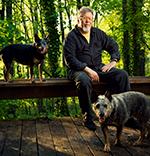 Phil Garrett, Williamsburg Oil Independent Artist, with dogs