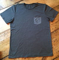 The Salty Surfer Tribal Vibe pocket shirt 100% Organic cotton.  These shirts are locally made in Los Angeles. They support the local economy, our local environment and our neighbors.  This piece was used using a high quality, low impact, garment-dye processing which gives it a unique character and lived in feel.  Please allow for slight color variation. Pre-shrunk.   #livesaltyordie