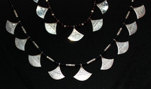 "Tchatchat necklace ""B"" is the lower necklace"
