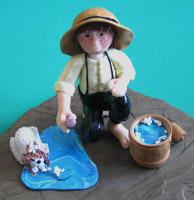 Amish Quilts - Amish boy washing puppy